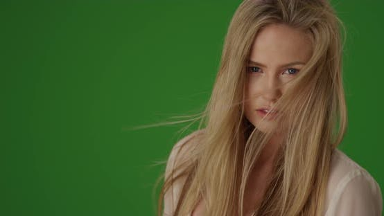 Thumbnail for Headshot of attractive young woman modeling for camera on green screen