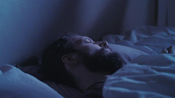 Sleep Disorder Night Terror Disturbed Man in Bed