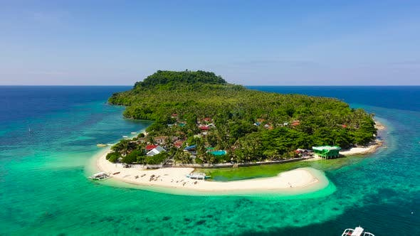 Himokilan Island, Leyte Island, Philippines. Tropical Island with a Village and a White Beach.