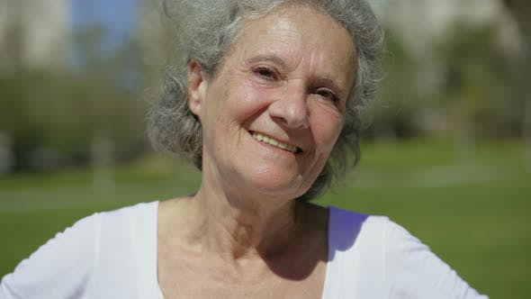 Thumbnail for Happy Beautiful Elderly Lady Smiling on Camera.