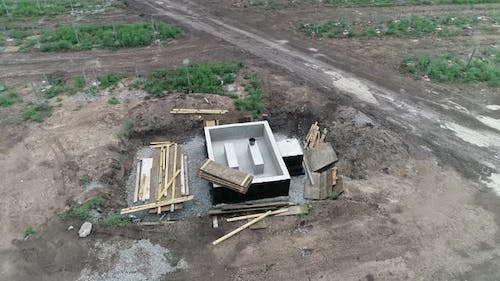 Aerial View of a Structure Built at a Construction Site in the Field