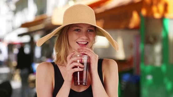 Thumbnail for Pretty Caucasian girl in her 20s smiling and laughing with her tea