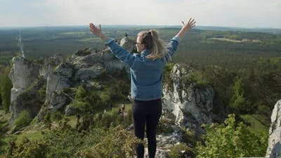 Successful Woman on a Mountain Top