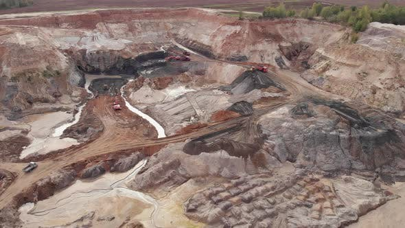 Thumbnail for Ore extraction. Opencast quarry with lots of machinery, aerial drone view.