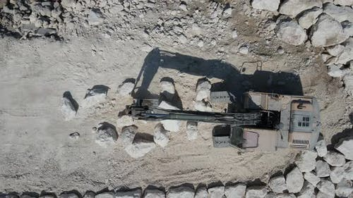 Crawler Bucket Does Stone Stacking