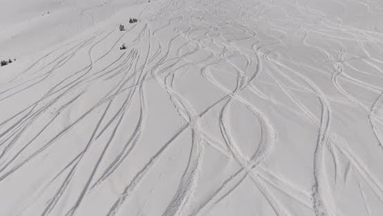 Cover Image for Aerial view Traces of skis on the snow mountain