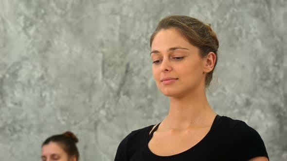 Thumbnail for Young Woman Practicing Meditation at Yoga Class