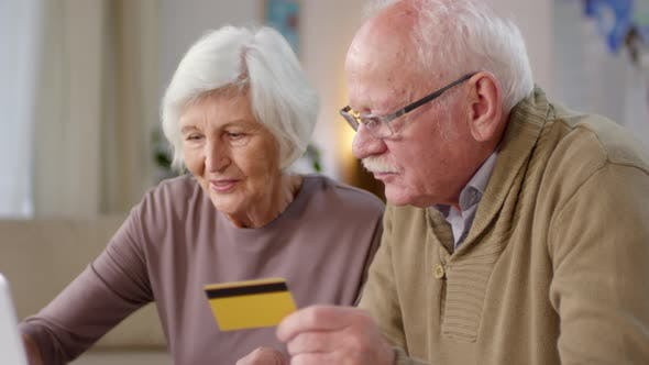 Retired Couple Making Online Payment