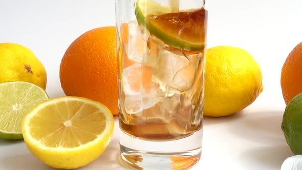 Preparation of Drink in Glass with Ice and Lime