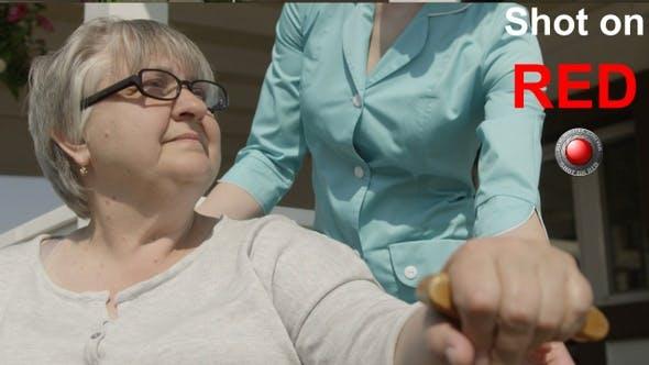 Thumbnail for Caretaker Helping Senior To Walk