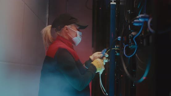 Thumbnail for Woman in Mask Repairing LED Screen During Show