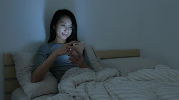 Thumbnail for Woman use phone in bedroom at night