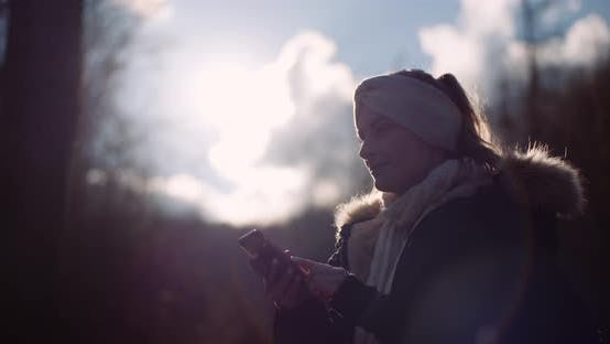 Thumbnail for Technology - Woman Using Smartphone To Take Picture in Autumn