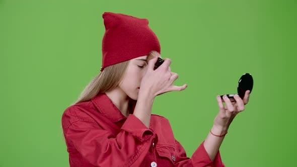 Thumbnail for Girl Is Applying Makeup with a Brush. Green Screen. Slow Motion