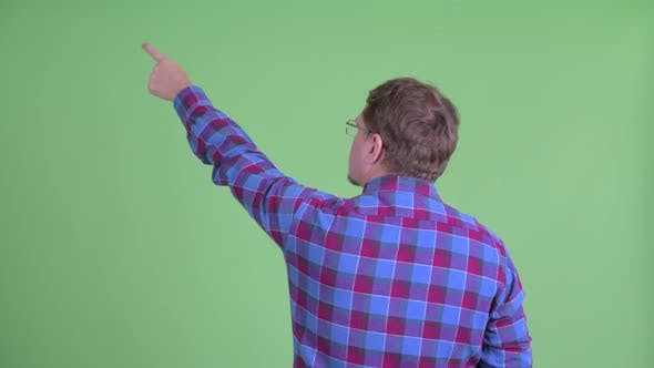 Thumbnail for Rear View of Overweight Bearded Hipster Man Pointing Finger and Directing
