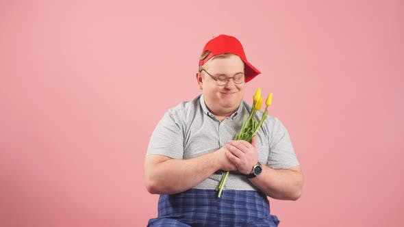 Thumbnail for Plump Young Man with Mournful Eyes Waiting for Girlfriend with Flowers