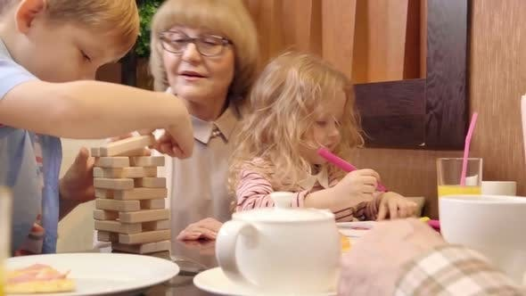 Cover Image for Senior Lady Enjoying Time with Grandkids in Restaurant