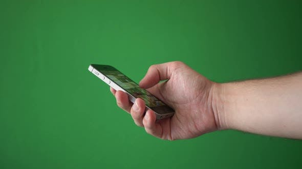 Thumbnail for Man Using Phone Isolated On Chroma Key Green Screen Background