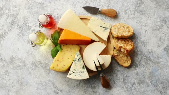 Thumbnail for Various Types of Cheese Served on Rustic Wooden Board