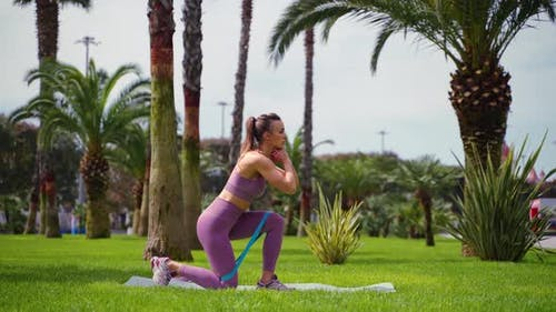 Workout with Resistance Band Woman Doing Reverse Lunge