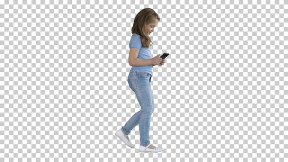Thumbnail for Little girl is playing with smartphone while walking, Alpha Channel