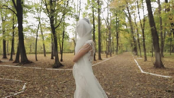 Thumbnail for Beautiful and Lovely Bride in Wedding Dress Running in the Park, Slow Motion
