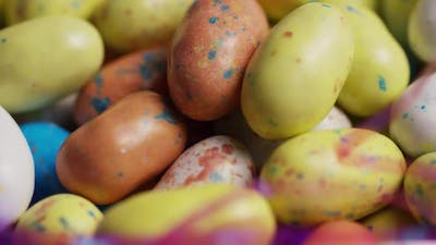 Rotating shot of colorful Easter candies on a bed of easter grass - EASTER