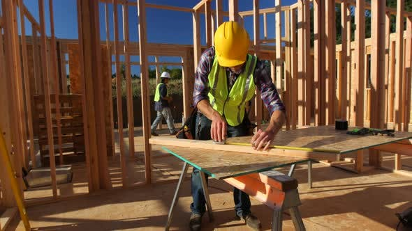 Thumbnail for Construction worker measuring board