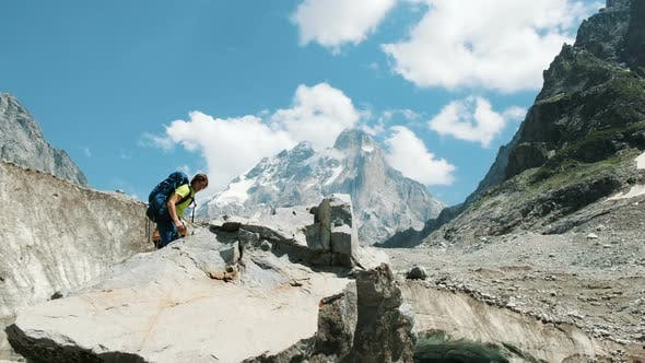 Thumbnail for Couple of Tourists with Backpacks in the Trek Climb To the Top of the Stone and Kiss