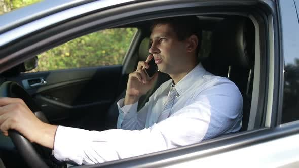 Thumbnail for Succesful Bussinessman Talking on Phone in Car