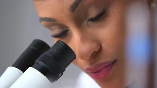 Sexy scientist looking at camera