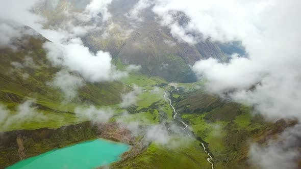 Thumbnail for Aerial view of cloudy, snowy Humantay Lake, Peru.