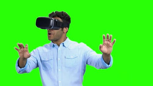 Young Scared Man Wearing Virtual Reality Glasses