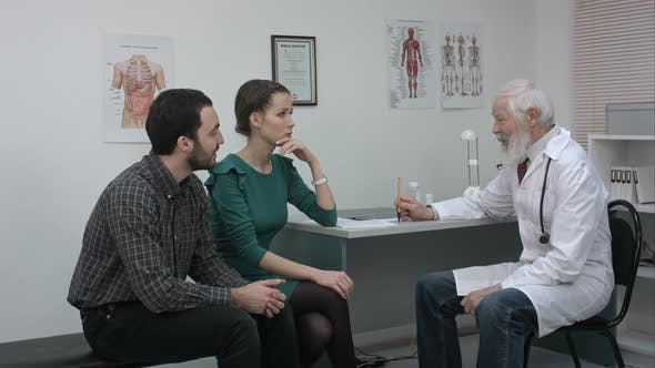 Thumbnail for Doctor Talking Nicely To Couple in Hospital.