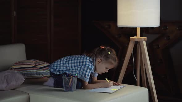 Thumbnail for Girl Child Draws Colored Pencils On Paper Picture In Interior