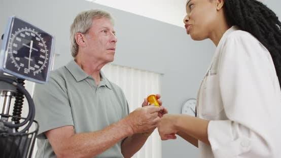 Thumbnail for Black woman doctor prescribing medicine to patient