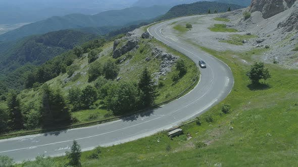 Thumbnail for Following Car Driving at Windy Ad Curvy Mountain Road in The Summer