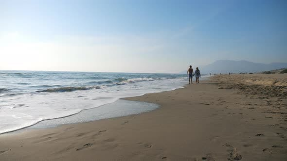 Thumbnail for Couple of Lovers Walking at Seashore Holding Hands During Resting on Resort. Man and Woman Strolling
