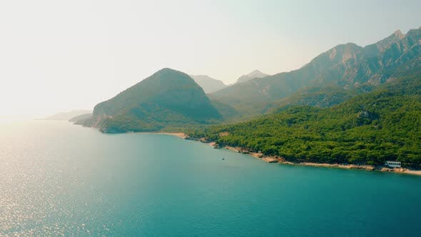 Beautiful Landscape with Turquoise Sea Water and Green Mountains