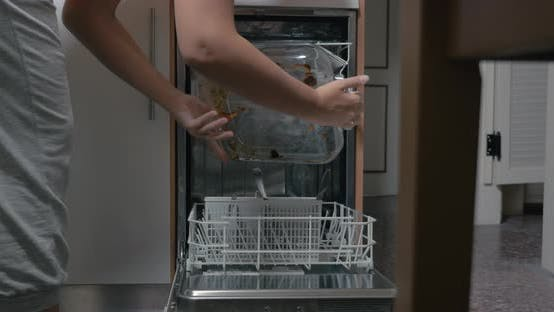 Thumbnail for Putting Dirty Dishes Into Dishwasher