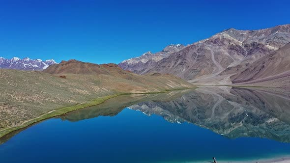 Beautiful Aerial Shot of Chandratal Lake , Spiti Valley , Moon Lake ,Tilt Up , Fast Moving