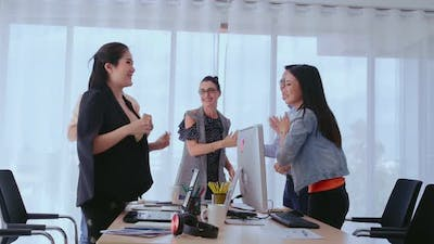 Successful Business People Celebrating Project Success at Office