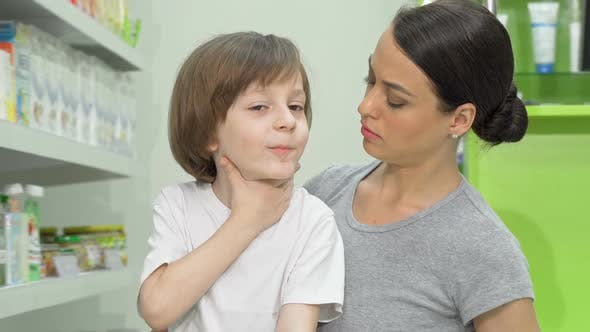 Thumbnail for Beautiful Woman Looking Disturbed As Her Little Son Coughing and Having Fever