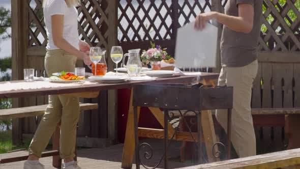 Thumbnail for Family Having BBQ on Summer Day