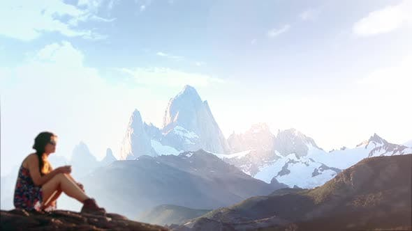 Thumbnail for Girl Drinking Mate with The Mount Fitz Roy in the Background (El Chalten, Argentina).