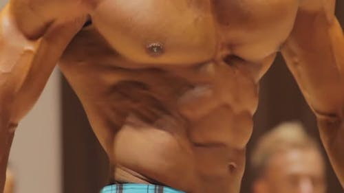 Close-Up of Tense Male Torso Muscles, Bodybuilder Physique, Perfect Six-Pack Abs