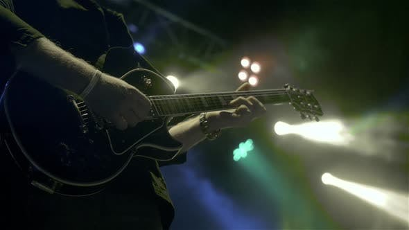 Silhouette of Guitar Player on Stage