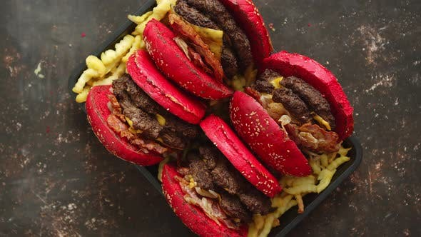 Thumbnail for A Set of Red Bun Homemade Delicious Burgers of Beef, Bacon, Cheese, Grilled Onion on a Dark Rusty