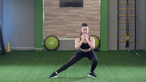 Young Female Performs a Warmup in the Gym a Fitness Coach Shows and Performs Exercises To Warm Up