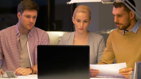 Thumbnail for Business Team with Laptop Working at Night Office